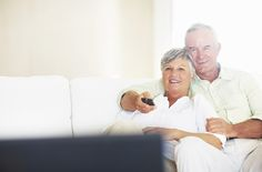 View Stock Photo of Relaxed Couple Watching Television In Living Room. Find premium, high-resolution photos at Getty Images. Home Automation System, Smart Home Automation, High Resolution Photos, Smart Technologies, All About Time, Investing, Advertising, How To Plan, Couple Photos