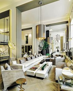 The main sitting area within the vast, open-plan ground floor of Kelly's home, a former auction house in Central London, is decorated in calm shades of taupe and white. 'I bought the building as a shell with nothing but a floor, an impressively high ceiling and the structural columns,' she says