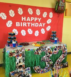 Lilo and Stitch Birthday Party; Luau theme; grass skirt for table; background on red tablecloth with Lilo's dress pattern
