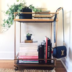 15 Things You'll Find In EVERY Fashion Girl's Apartment #refinery29 http://www.refinery29.com/fashion-home-decor-items#slide2 Repurposed Bar Carts Without a real living room, where else were we supposed to put all those coffee-table books?