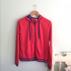 H&M Hooded Jacket Divided by H&M sporty hooded jacket.  In excellent condition.  Size US 12 but runs small and fits like size M.  Pet & smoke free home. H&M Jackets & Coats