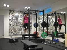 Wall collage in the home gym to keep you motivated! - Decoist
