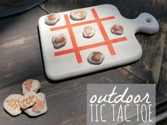 What an interesting idea! Create your own Tic-Tac-Toe board by taking a cutting board, marking the lines with tape and paint and painting stones with different designs.