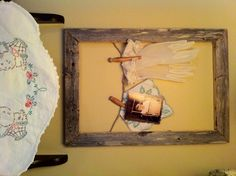 Old barn wood frame, vintage gloves and a baby pic of my grandfather. Simple beauty.