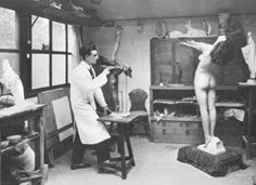 Max Le Verrier in his studio modelling his 1928 bronze masterpiece CLARTE, a figural lamp inspired, among others, by Josephine Baker, who like him loved animals.