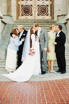A kiss photo for the bride and groom and their parents!