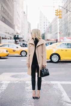Mister Woof Loves... this beige/camel coat, black trousers and the NYC backdrop is pretty amazing!