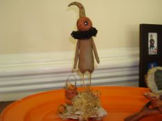 Love him...All clay and wire and the stand is Petrified wood from my daddy's yard a little treasure I picked up with our walks around the yard. By Paige Lonon