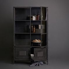 The Ronja is a sturdy display cabinet entirely made of metal, which is lacquered in a black colour. The black metal gives the building a strong industrial character. This cabinet has three shelves, the top three are covered by glass offering you a chance Furniture, Cabinet Styles, Metal Cabinet, Cabinet, Metal Sideboard, Metal Display, Display Cabinet, Bookcase Design, Large Cabinet