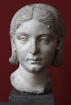 A Third Century Roman Woman (Copenhagen 1491) Roman marble portrait of an unidentified Roman woman. Dated by the Ny Carlsberg Glyptotek to ca. 205-230 CE. Inv. 1491