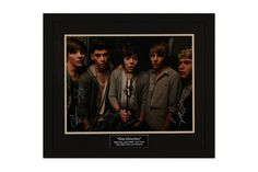 One Direction Autographed Photo - Raise more money by adding silent auction items such as autographed memorabilia on consignment from CharityGrow.com