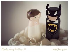 Wedding Cake Topper- So cute! This wooden people cake topper was handmade by the brides parents. Obviously the groom is a batman fan. :)