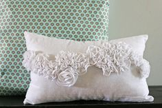 V and Co.: winning tutorial: the snow ruffle pillow.  http://www.vanessachristenson.com/2009/12/winning-tutorial-snow-ruffle-pillow.html