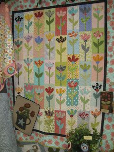 I could use up a lot of my scraps on a cute flower quilt like this one. This quilt is called Tessie from Under The Garden Moon.