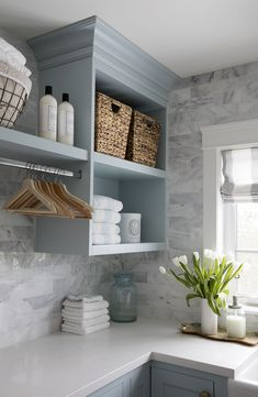 Jillian Harris laundry room- love the light blue and marble | Home | Laundry Room | Mud Room