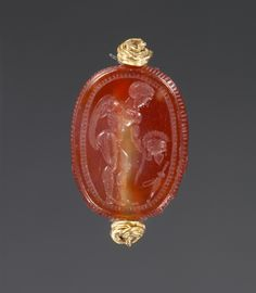 Scarab; Unknown; Etruria; second half of 5th century B.C.; Carnelian and gold; 0.9 x 1.5 x 1 cm (3/8 x 9/16 x 3/8 in.); 81.AN.76.134