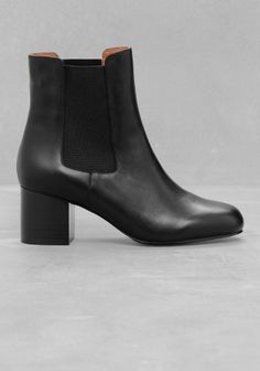 A solid block heel is combined with a sleek and understated design in these classic ankle boots with a slightly higher shaft.