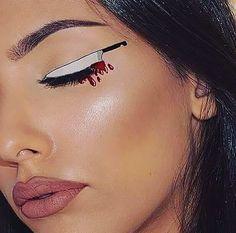 cuchillo pintado en un ojo