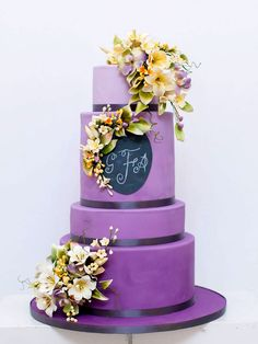 Monogrammed purple ombre cake with yellow flowers | Canada's Prettiest Wedding Cakes For 2015 via @weddingbellsmag