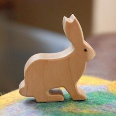 Carved Wooden RABBIT Bunny Jackrabbit, Handmade Toy Animal, Waldorf Inspired Our hand-made wooden toy animals are perfect for a nature table or for hours of creative play. This mischievous jack rabbit is approximately 2-1/2 long and 2-1/4 tall. Our wooden animals are hand-made from