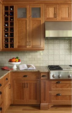 transitional kitchen light countertops | Casual Transitional Kitchen by Lisa Peck
