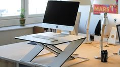 Oploft Height-Adjustable Sit Stand Desk http://www.oploft.com/ Don't forget to check out these 12 Modern Small Home Office Desks http://vurni.com/modern-small-home-office-desks/