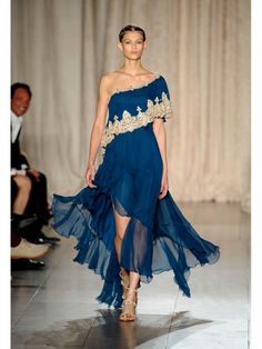 Marchesa sari-inspired blue and gold one-shoulder gown shown during Mercedes Benz Fashion Week Spring/Summer 2013 in New York City. #models #fashion #NYFW