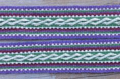 ASpinnerWeaver: The Colossally Long Sash. Click through to this blog post to find the chart for weaving this spiraling pattern.