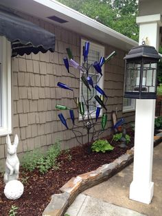 My bottle tree.  Love the dragon flies made from spark plugs and old forks.