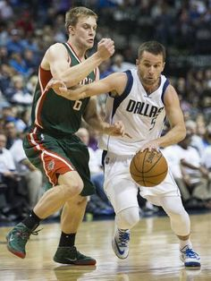 Dallas Mavericks J.J. Barea drives past Milwaukee Bucks guard Nate Wolters (6) during the second half of their game on Sunday, December 7, 2014 in Dallas, Texas. (Ashley Landis/The Dallas Morning News)