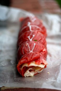 Grilled and stuffed flank steak. Have the butcher fillet and tenderize your cut.