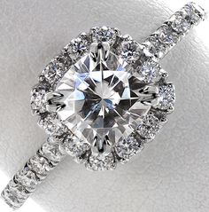 hand cut micro pave engagement ring with halo and claw prongs