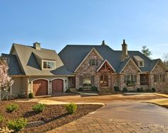 French Country home stone, stucco, and cedar shakes