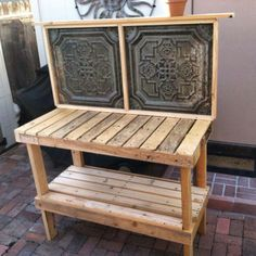 Pallet Potting Bench by David J. Nelson with vintage ceiling tiles for back splashes, made with pallets and some 2 x 4's.