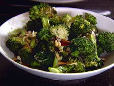 Get this all-star, easy-to-follow Parmesan-Roasted Broccoli recipe from Ina Garten - I coated mine in oil, topped with salt and pepper, baked for around 18 minutes, and then topped with basil pesto and shredded parmesan cheese.