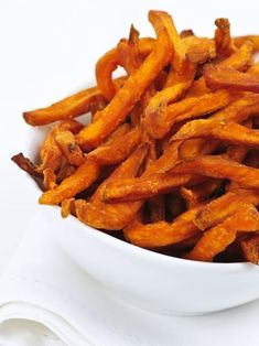 You won't miss the calories or crunch with these addictive baked sweet potato fries. Baked to perfection and simply seasoned this guiltless side accompanies any sensible meal. Sweet Potato Recipes Healthy, Healthy Potatoes, Fried Potatoes, Healthy Snacks, Vegetarian Recipes, Healthy Recipes, Healthy Eating, Clean Eating, Eating Light