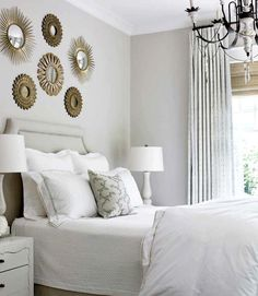 "Giles bought an antique starburst mirror for a client's bedroom, then realized that hanging a grouping over the bed in various shapes and sizes would make a bigger statement. The best design advice she ever got? ""'God is in the details,' That always stuck with me,"" Giles says. - HouseBeautiful.com"