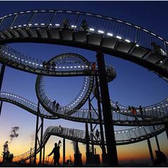"""Magic Mountain"""" looks like a conventional roller coaster, but get up close and you'll realize its curves aren't meant for a quick adrenaline rush. The steel structure, which made its public debut Nov. 13, is actually a giant sculpture by German artists Heike Mutter and Ulrich Genth. Adrenaline junkies pay attention this is your quickie! Lol"""