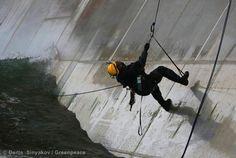 Kumi Naidoo, Executive Director of Greenpeace International, climbs the Prirazlomnaya oil platform.    Sign the petition: savethearctic.org
