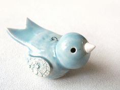 don't like the shape, but I like the color and the design on white clay for the wings with the glaze wiped off