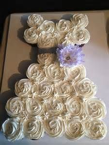 So if we use lavender as the color scheme we can do this and accent the cake with a lavender flower and since theres going to be like 50-60 people invited to this thing according to Donna. I was thinking we can use mini cupcakes and make 4 little bridesmaid versions of this in lavender dresses. I know how to bake from scratch and frost like that so I can make this