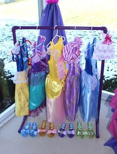 Create a disney princess dressing room at your child's birthday party so all her royal guests can play dress up. Perfect activity idea for princess themed birthday party.