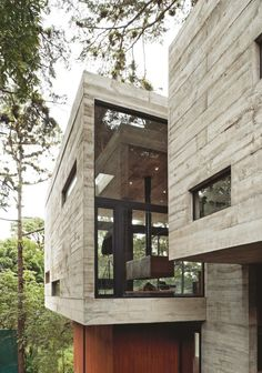 The main structural component is exposed concrete, which shows the rustic texture of the wood formwork, allowing a dialogue between the formal element and the textures of the forest.--Casa Corallo by Paz Arquitectura