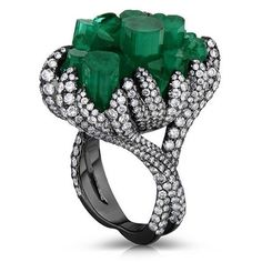 An emerald and diamond ring, by Cicada New York.