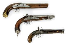 A flintlock rifled officer's pistol; together with two large percussion pistols of service type. The first early 19th century.