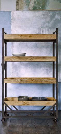 The Ancona shelving unit in mango wood and iron. Moveable storage with an industrial edge, create a display or use the sturdy shelves to store you most loved nick-nacks with the Ancona shelving. Its castor feet mean it can take centre stage for easy access or tuck away neatly in the corner.
