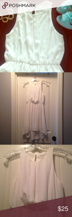 White Dress Beautiful white high-low dress! Like new and perfect for any special occasion! Great fit! Would be perfect for a bride at showers or engagement parties! Everly Dresses