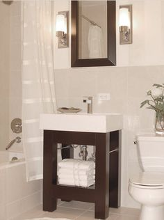 Sized To Fit For A Small Bath Room. A Miniature Vanity With A Small Storage  Shelf And Matching Mirror Are A Perfect Fit For This Contemporary Bathroom.