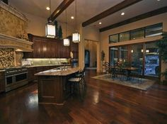 dark cabinets, dark hard wood floors, cedar beams <3