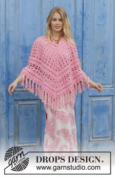 Crocheted poncho with lace pattern and fringes, worked top down. Sizes S - XXXL. The piece is worked in DROPS Paris.